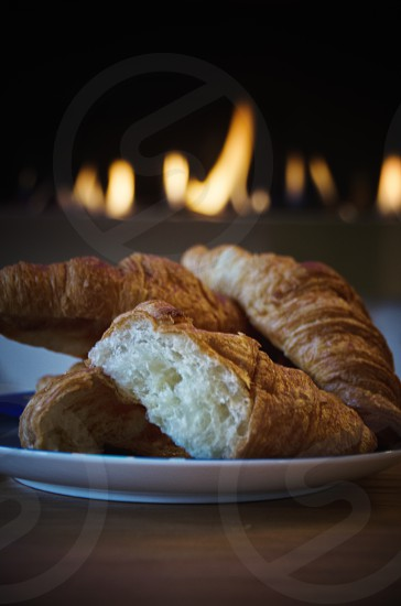 Croissant comfort fire warm warmth comfort food toasty home comfort pastry breakfast brunch photo