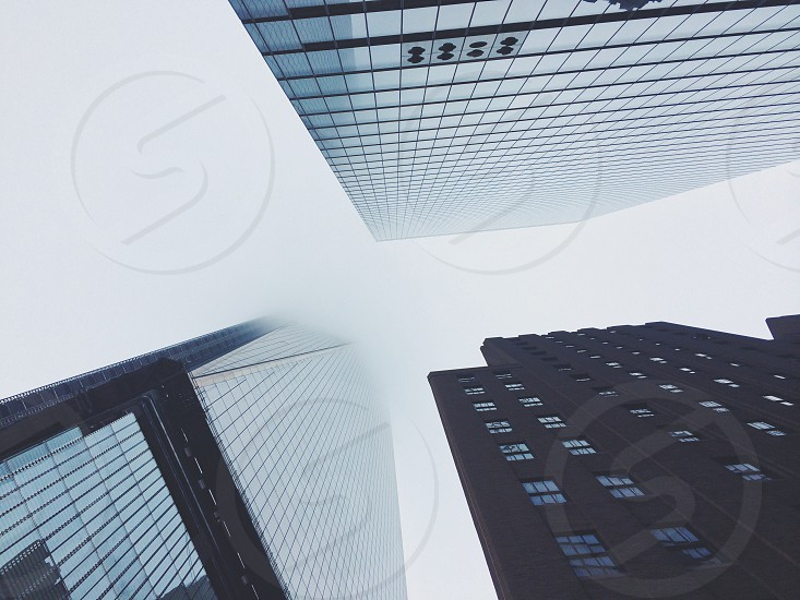 black and gray high rise building in low angle photography photo