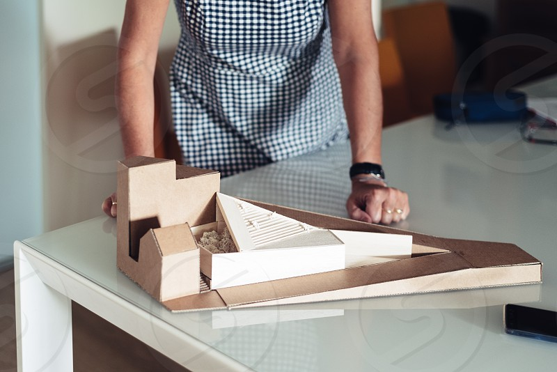 Woman architect with to architectural model photo