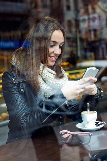 Pretty young woman at coffee break photo