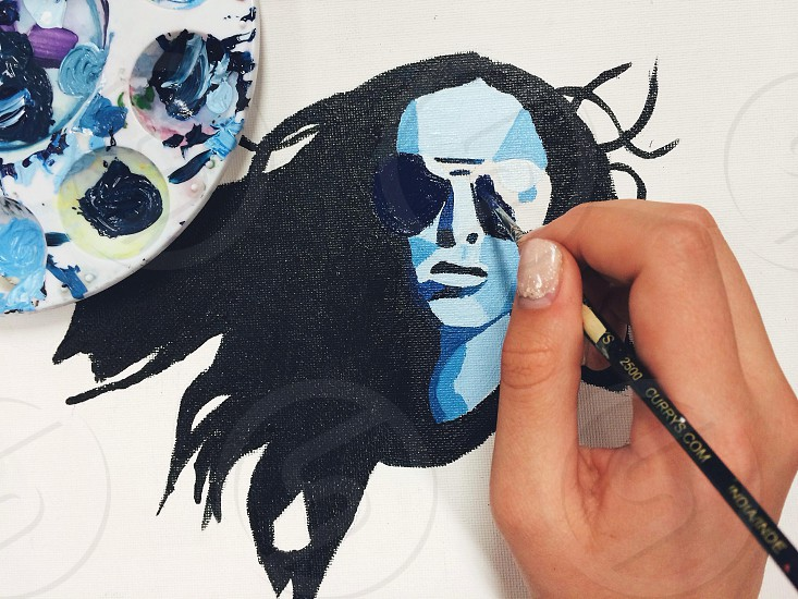 handpainted portrait of woman wearing sunglasses photo