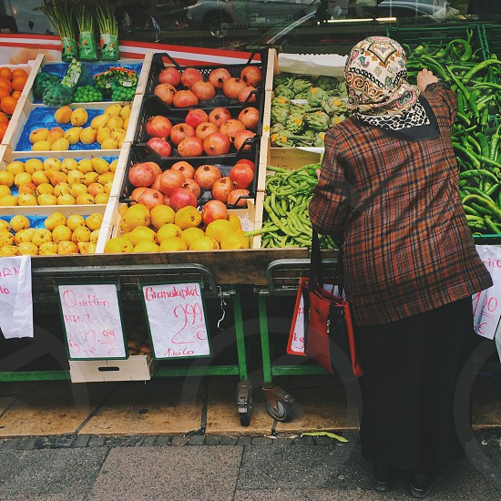 woman buying vegetable photography photo