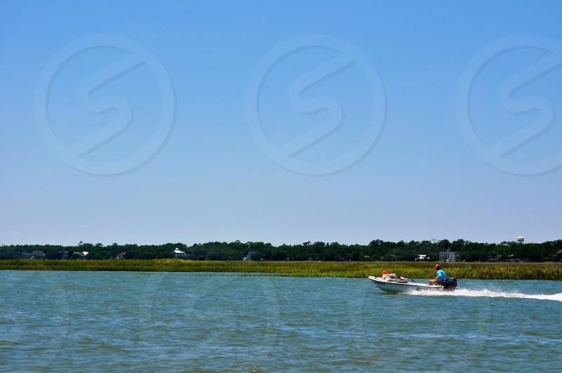 Boat on the water - South Carolina - Waccamaw River photo