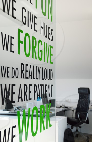 Interior of an office with motivational stickers on glass wall. photo
