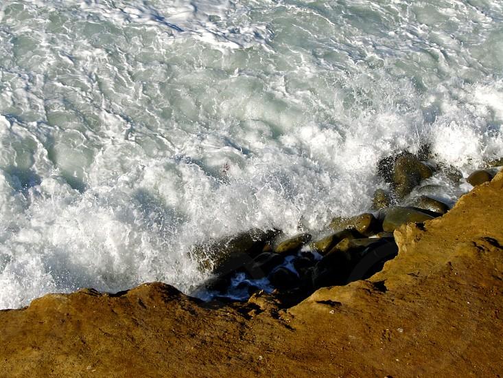Foam on the rocks photo