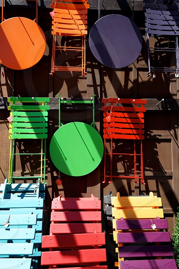 I loved how colorful these chairs and tables were. Because they were hanging from a wall and the sun was shining on them the colors seemed even more brilliant. photo