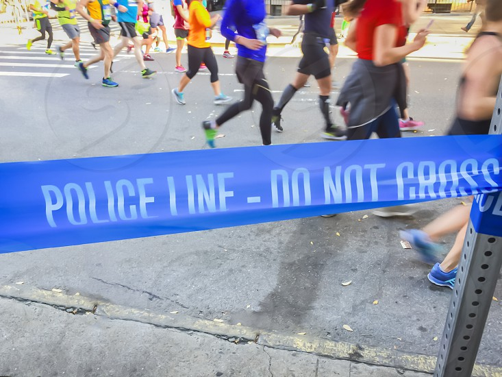 Blue police line during a city marathon. Safety and fitness concepts photo