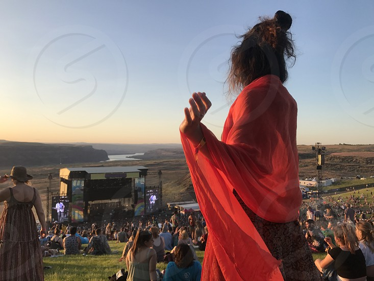 Music festival sunset Dancing dance dancer coral pink happy glowing flowy flow groove groovy springtime summer gorge amphitheater celebrate cheering cheer Joy joyful living alive free freedom happy  photo