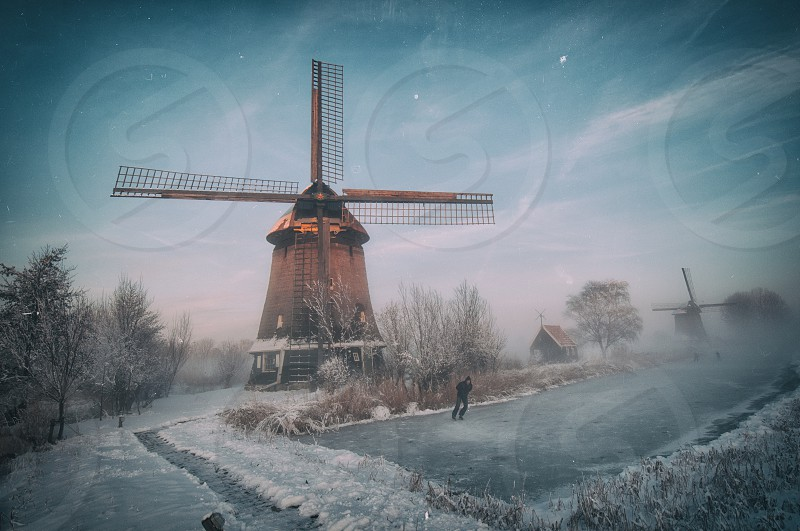 Typical Holland... iceskating windmill snow photo