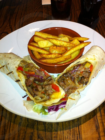 Succulent Steak Fajita wraps along side chips sprinkled with PeriPeri Salt lovely photo