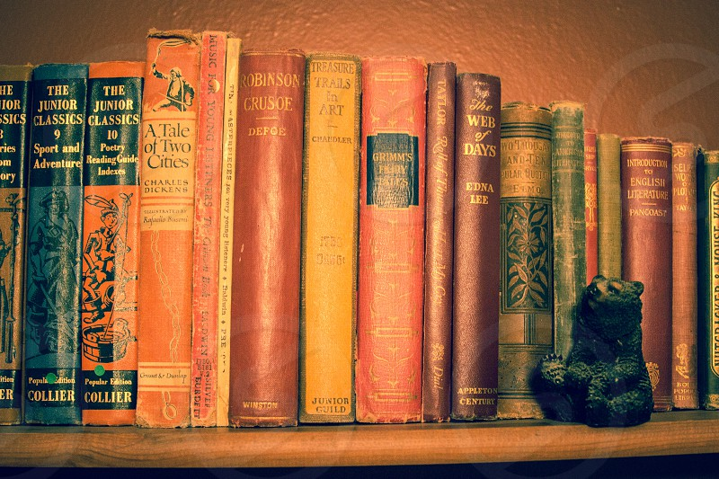 Antique books on a bookshelf photo