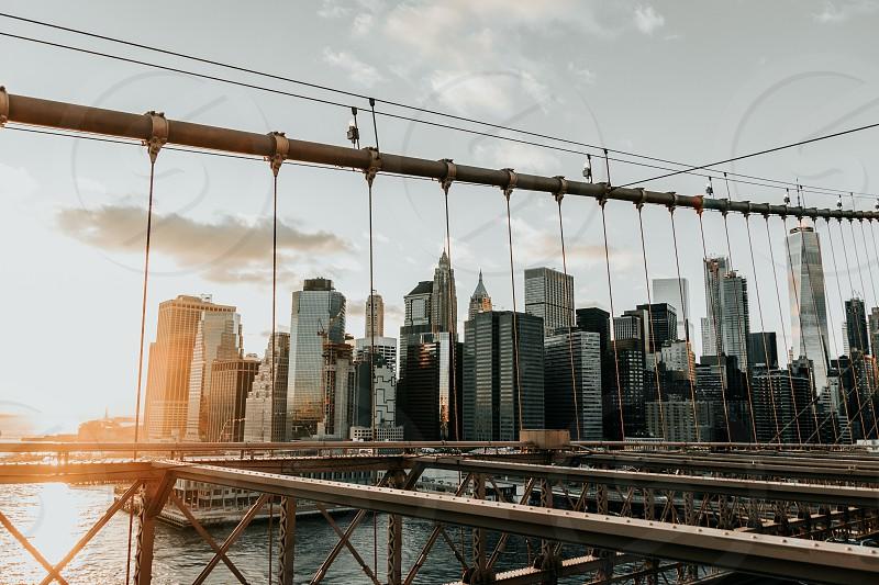Brooklyn bridge sunset nyc skyline photo