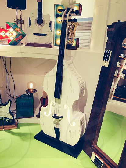 white cello near white table photo