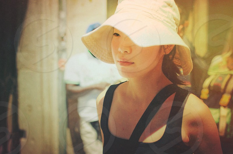 woman wearing white bucket hat and black tank top photo