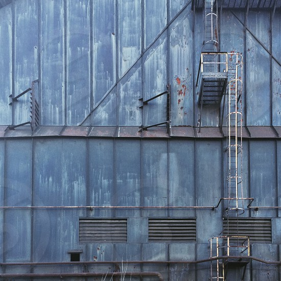 blue building with emergency exit stairs photo