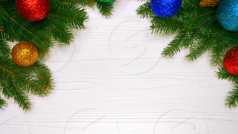Beautiful holidays background of green spruce branches on white white wooden table decorated with christmas balls. Top view. Copy space. Happy new year 2019. photo