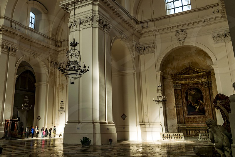 Light falling at noon through the windows of the Benedictine Monastery in Catania Sicily photo