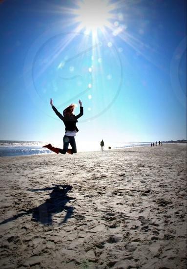 Jumping on Folly beach.  photo