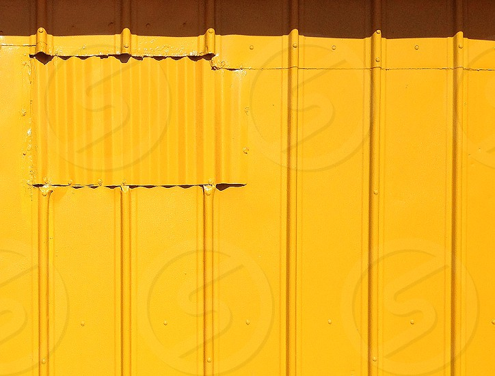 Geometric abstract of a yellow metal wall photo