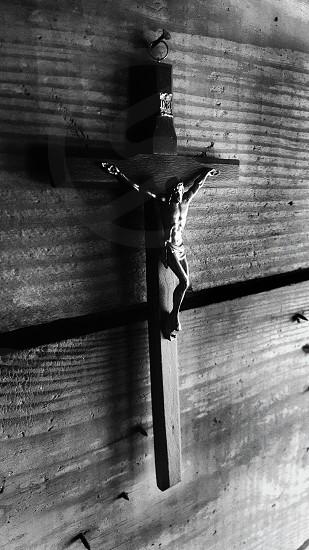 Jesus Christ Christian Catholic crucifix wood nail iron light grain black white religion photo