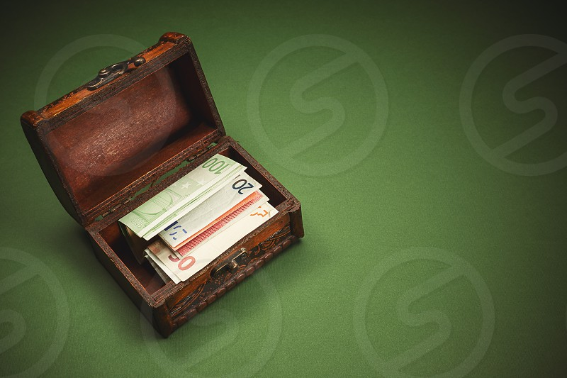 Conceptual image showing souvenir suitcase full of euro banknotes.  photo