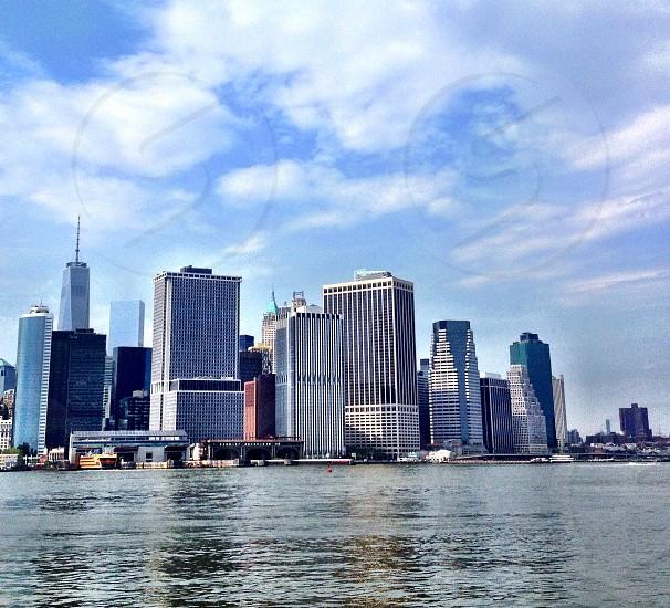 Lower Manhattan New York City skyline blue skies  photo