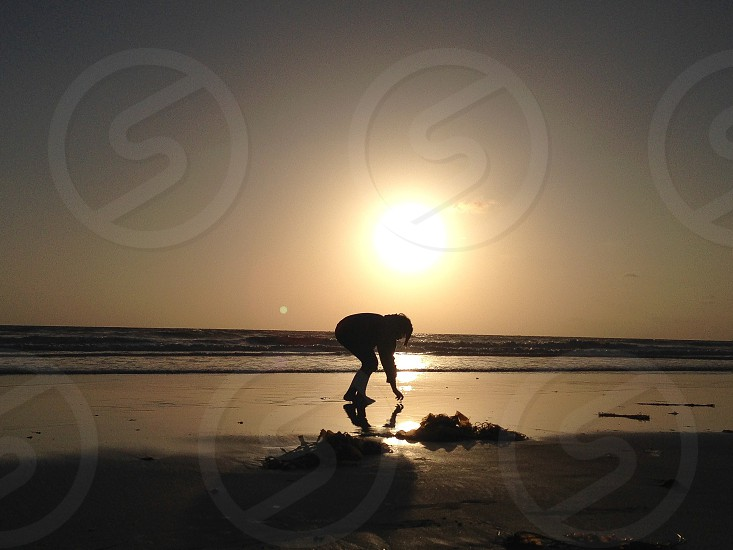woman silhouette in ocean view  photo