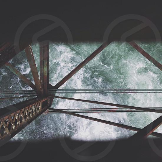 brass metal bridge frame  on sea  photo