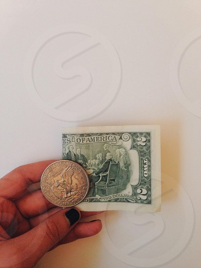 1 2 us dollar bill and 1 one us dollar coin photo
