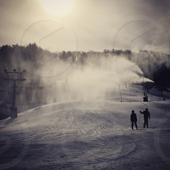 ski skiers skiing winter cold snow frozen sun silhouette Holiday Valley Ellicottville NY New York ski resort photo