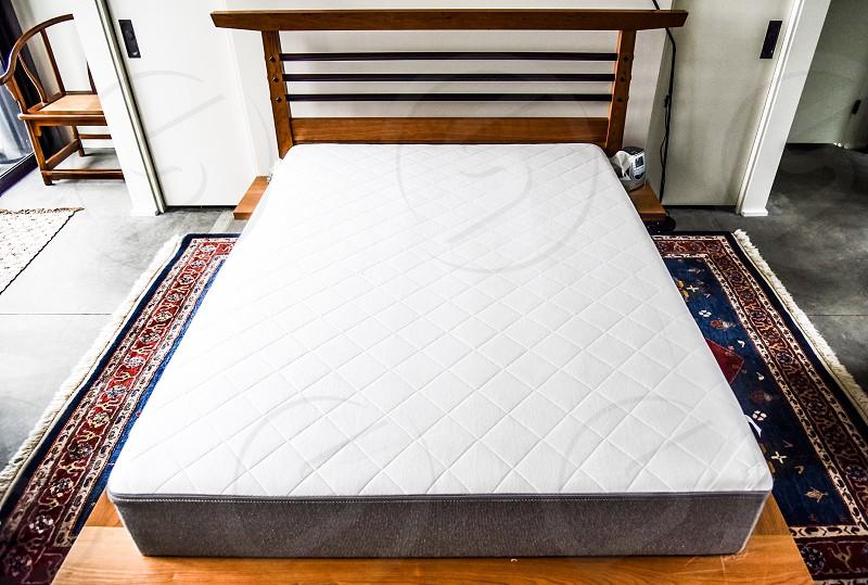 Bed mattress masculine interior no bedding photo