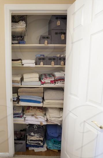 Organized linen closet photo