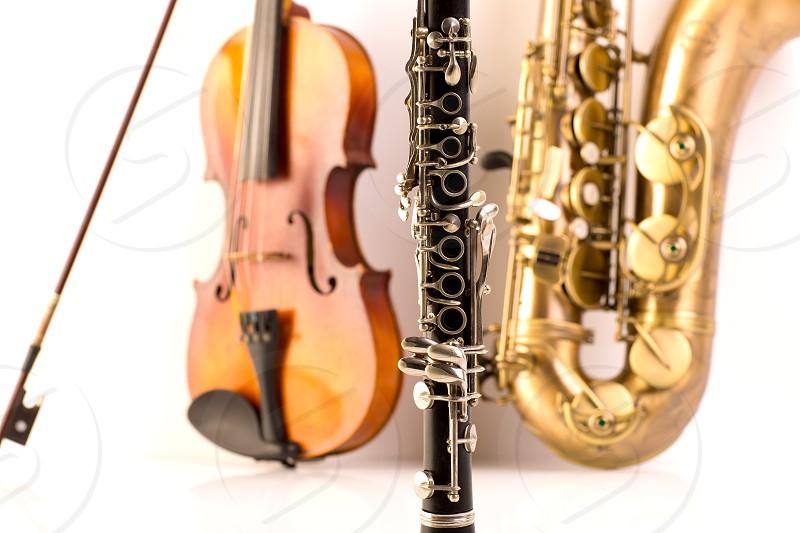 Music Sax tenor saxophone violin and clarinet in white background photo