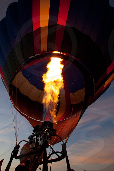 Hot air balloon getting ready for lift off at sunrise photo