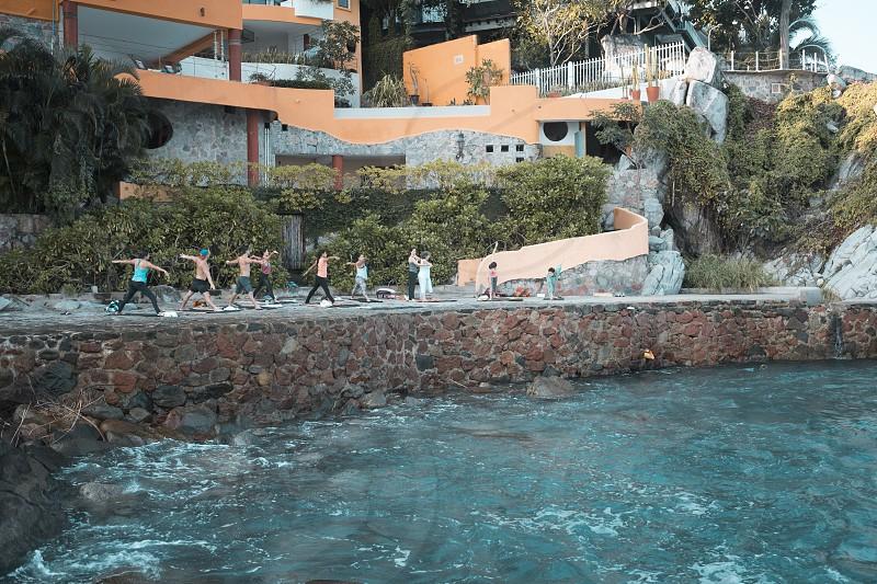 Group of multiple people exercising. Yoga retreat Puerto Vallarta - Mismaloya Mexico. Horizontal photo. photo