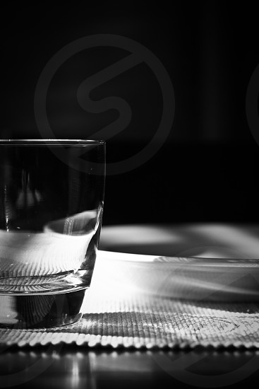 grayscale closeup photography of old fashioned glass photo