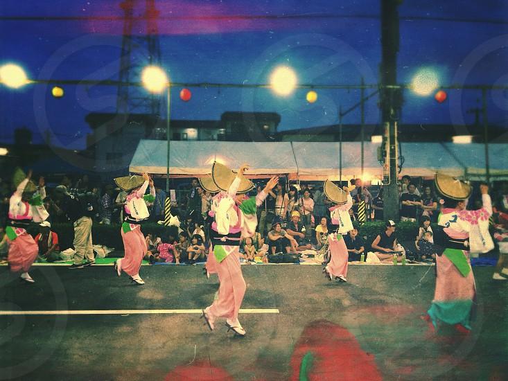 people dancing on street photo