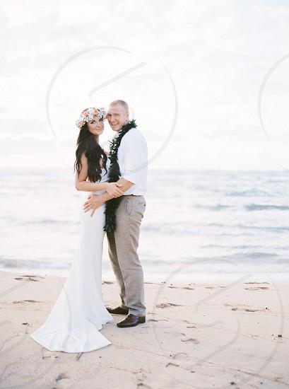 woman in white tank mermaid wedding gown smiling photo