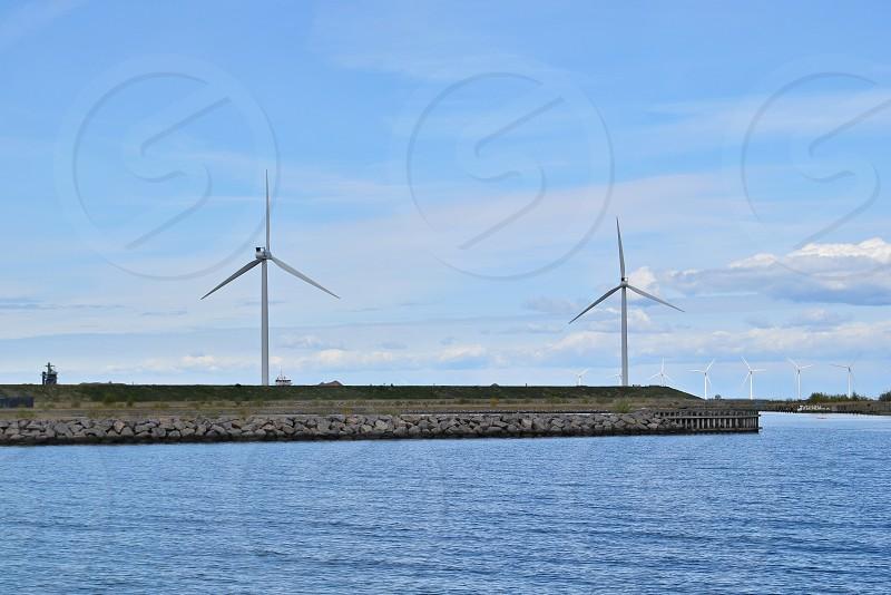 Wind farm along the Baltic Sea in Copenhagen Denmark photo