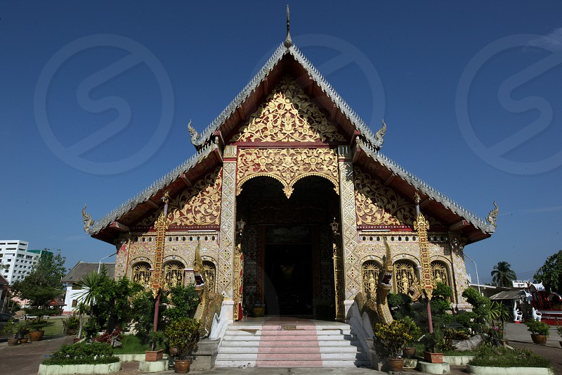 the  Wat Jet Yot  in the old town of the city of Chiang Rai in the north provinz of chiang Rai in the north of Thailand in Southeastasia. photo