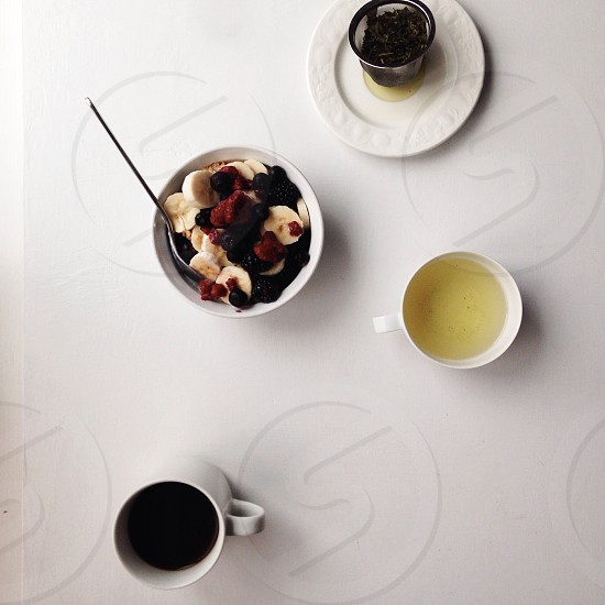 white ceramic cup with black coffee  photo