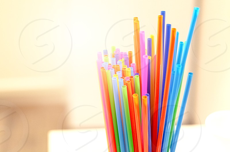 group of plastic straws of various colors Global warming and plastic pollution. Environmental issues. Party and refreshment. photo