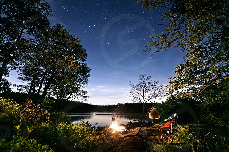 Camping lakeside lake hiking night stars landscape fire campfire wilderness adventure nature trees water wide angle backpacking photo