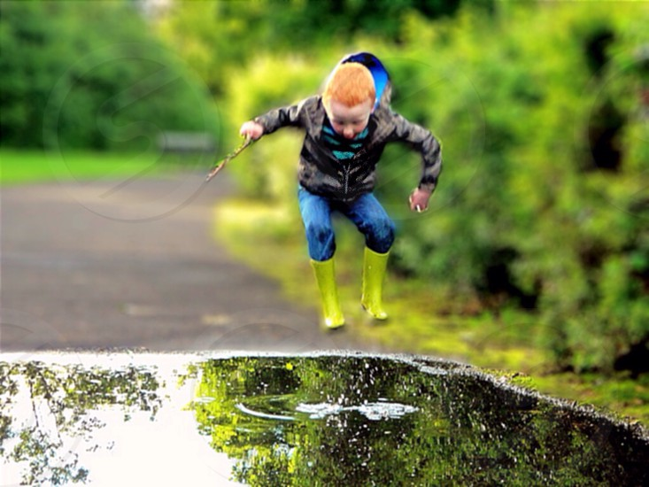 My son jumping in the puddles and loving every minute!  photo