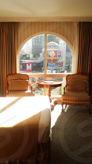 Hotel room window view table chairs  photo