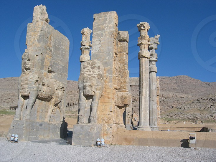The Remains Of Several Monumental Buildings On A Vast Stone Terrace Surrounded By A Brick Wall Persepolis Iran By Ali Koochek Photo Stock Snapwire