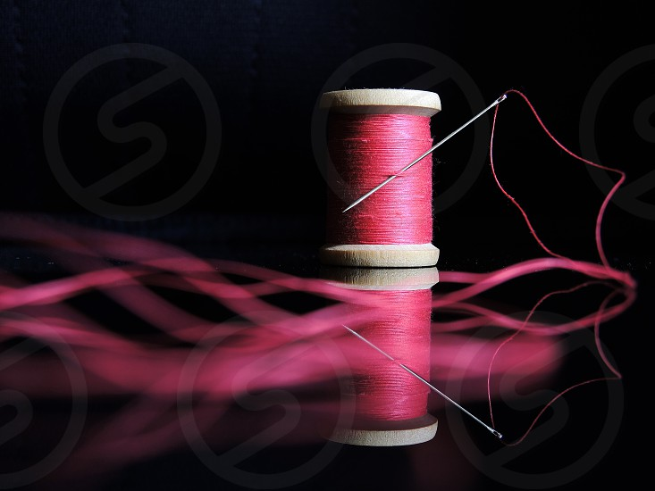 pink thread with needle photo