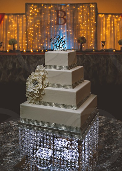 white square tiered wedding cake with white floral accent photo