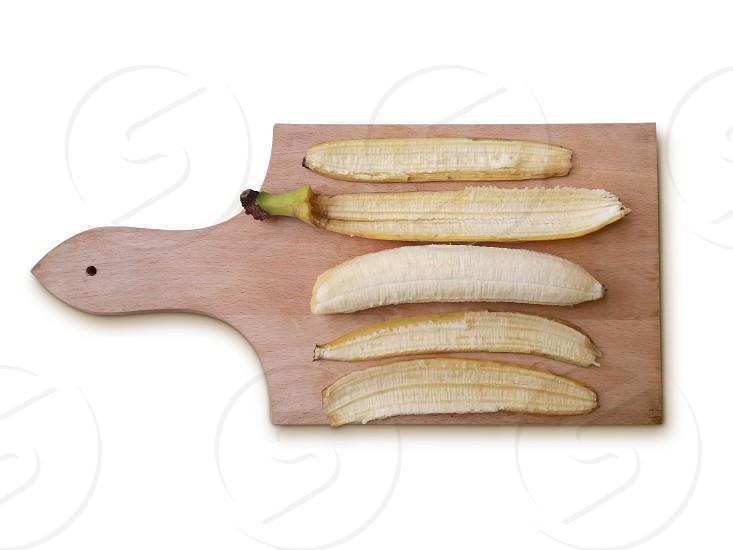 Peeled banana on the desk photo