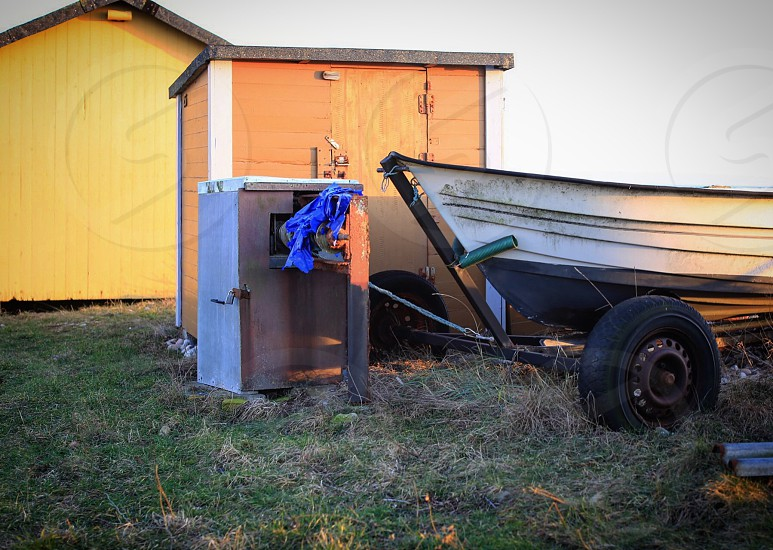 Boating lifestyle  boat seaside boat hut  huts land winter photo